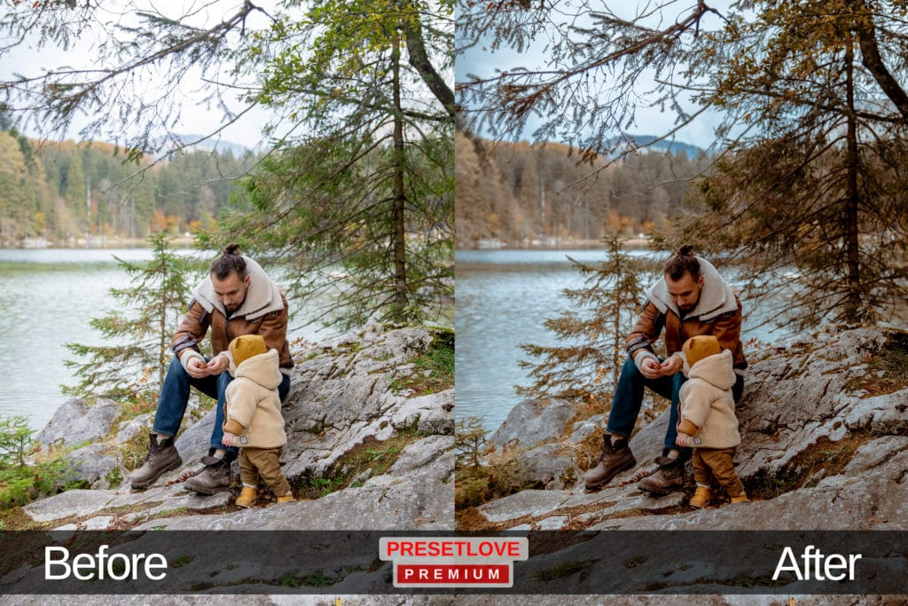 An outdoor photo of a man and his child by the lake