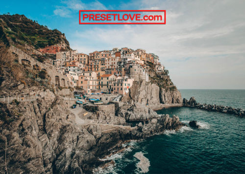 A warm and vibrant photo of the Cinque Terre, with a film travel preset applied